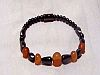 Single Strand Irridescent Bracelet with orange beads